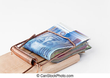 many swiss franc notes in mousetrap