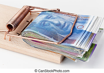 swiss franc in mousetrap - many swiss francs banknotes in...