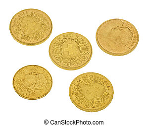 Swiss gold coins of the beginning of the 20th century isolated on white background.