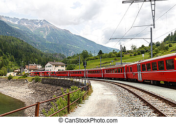 Swiss mountain train Bernina Express arriving in a small...