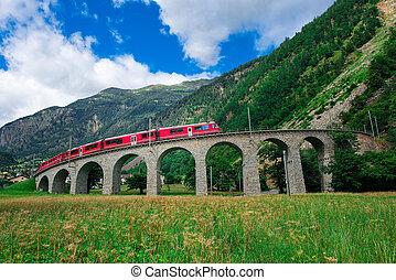 Swiss mountain train Bernina Express Cross the bridge in the circle to gain altitude