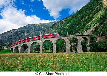 Swiss mountain train Bernina Express Cross the bridge in the circle to gain altitude