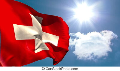 Swiss national flag waving on blue sky background with sun...