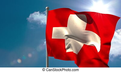 Swiss national flag waving on flagpole on blue sky...