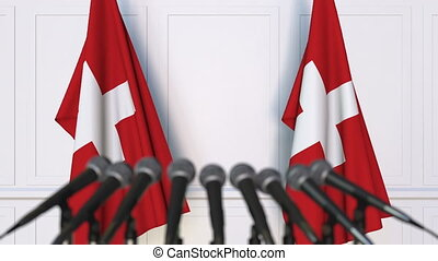 Swiss official press conference. Flags of Switzerland and...