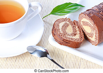Swiss roll with condensed milk cream and a cup of tea