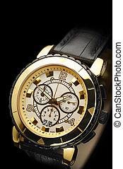 swiss watch. gold yellow, black leather