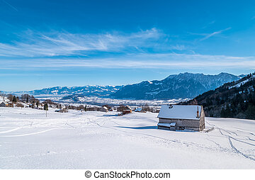 Swiss Winter - Barn covered in snow - A small barn covered...