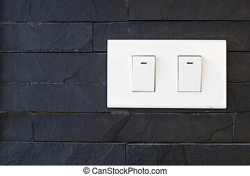 switch light on black stone wall