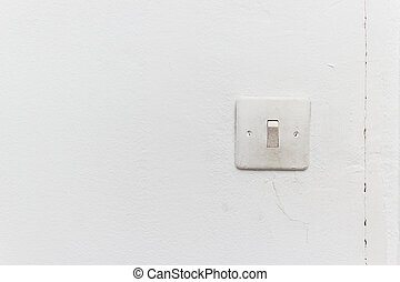 switch on the wall - old light switch on the white wall