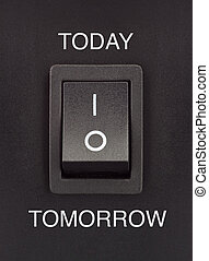 Today or Tomorrow black toggle switch on black surface positive negative