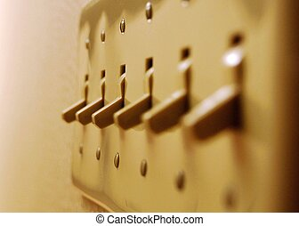 Switches - A close up photograph of light switches.