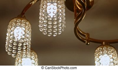 Switching light off cut-glass chandelier
