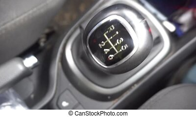 switching manual gearbox, the man's hand shifts gears in the car