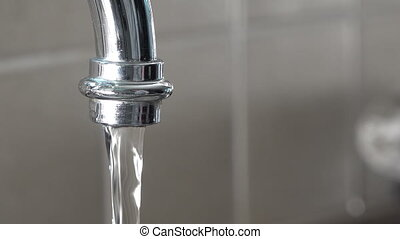 Switching water tap on and off.