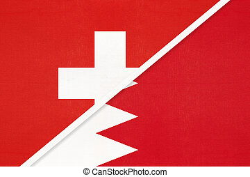 Switzerland or Swiss Confederation and Bahrain, symbol of national flags from textile. Relationship, partnership and championship between European and Asian countries.