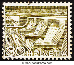 SWITZERLAND - CIRCA 1949: a stamp printed in the Switzerland shows Dam and Power Station, Hydroelectric Power, circa 1949