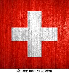 Switzerland Flag on wood background