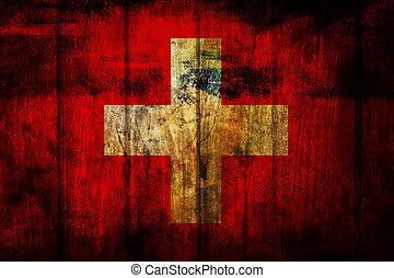 switzerland flag on wood plank background