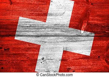 Switzerland Flag painted on old wood plank background