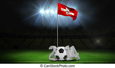 Switzerland national flag waving on pole with 2014 message on football pitch