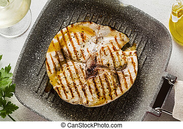 swordfish steak fried on grill pan with olive oil and spices...