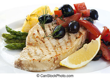 Swordfish with an olive and tomato salsa, asparagus, and...