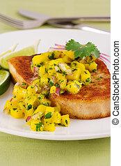 Swordfish with mango salsa and lime
