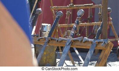 Swords Handles in the Sun - Deadly heavy swords in the sun.
