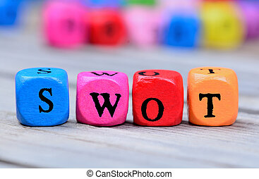 Swot word on wooden table