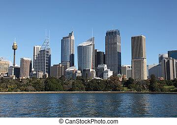 Sydney City Skyline view across farm cove. Sydney is Australia's largest city and a popular tourist destination.