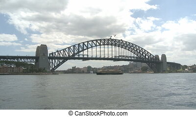Sydney Harbor Bridge at daytime with ships in the Harbor Bay...