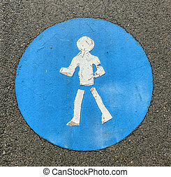 symbol for pathway and icon for pedestrians on asphalt