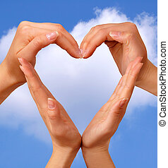 Symbol Heart 3 - Female hands showing heart sign love...