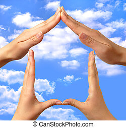 Symbol home 2 - Female hands showing home sign family house...