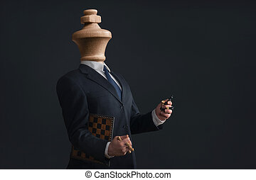 Symbol of a narcissist without head and with pawns in the hands