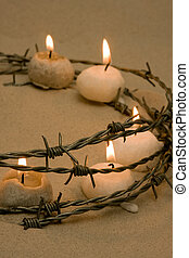 Candles in barbed wire, symbol of civil rights and hope