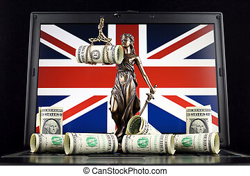 Symbol of law and justice, banknotes of one dollar and United Kingdom Flag on laptop. Studio shot.