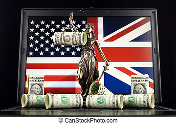 Symbol of law and justice, banknotes of one dollar and United States and United Kingdom Flag on laptop. Studio shot.