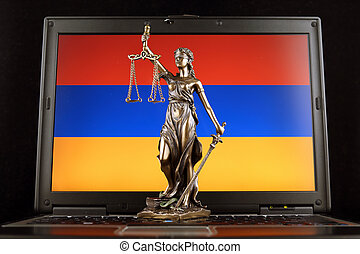 Symbol of law and justice with Armenia Flag on laptop. Studio shot.