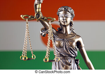 Symbol of law and justice with Niger Flag. Close up.