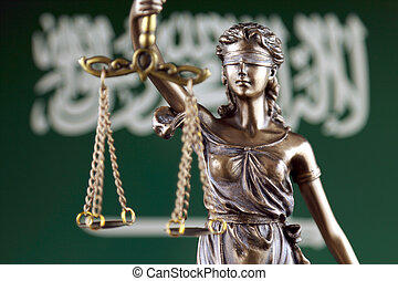 Symbol of law and justice with Saudi Arabia Flag. Close up.
