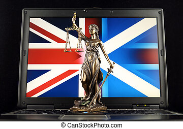 Symbol of law and justice with Scotland and United Kingdom Flag on laptop. Studio shot.