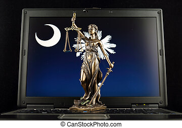 Symbol of law and justice with South Carolina State Flag on laptop. Studio shot.