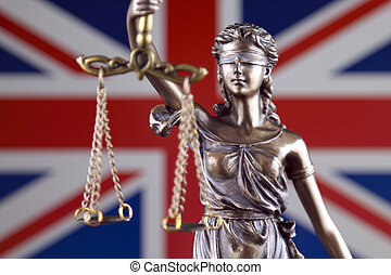 Symbol of law and justice with United Kingdom Flag. Close up.