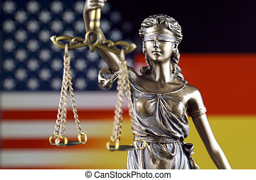 Symbol of law and justice with United States and Germany Flag. Close up.