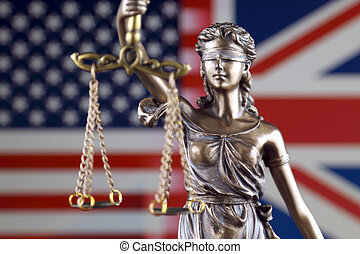 Symbol of law and justice with United States and United Kingdom Flag. Close up.