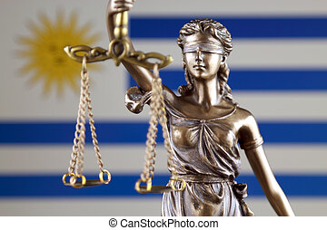 Symbol of law and justice with Uruguay Flag. Close up.