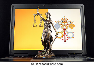 Symbol of law and justice with Vatican City Flag on laptop. Studio shot.