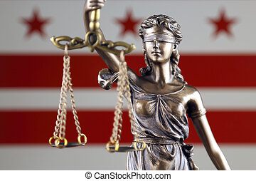 Symbol of law and justice with Washington DC Flag. Close up.
